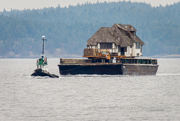 Home being moved by barge