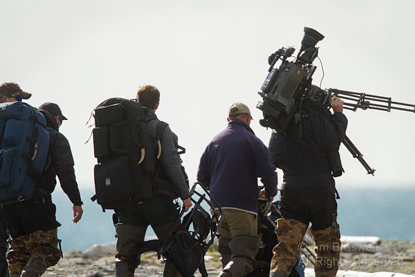 The film crew heads out to film the bears, along the coastline of Hallo Bay, Alaska