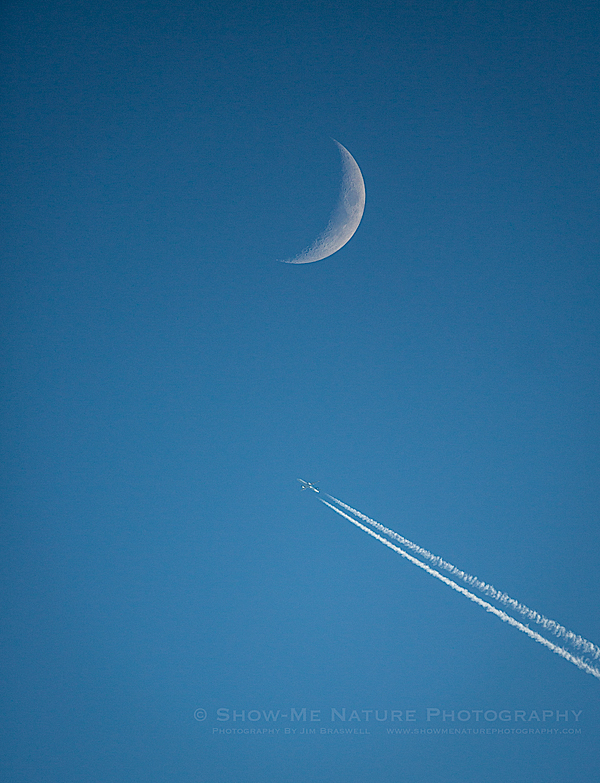 Commercial Jet Flies Near the Daytime Moon