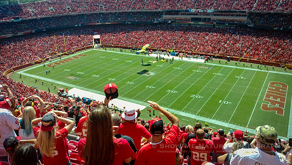 Navy SEAL parachutes into Arrowhead Stadium