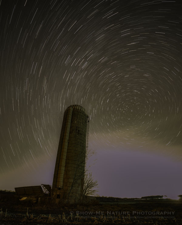 Star Trails over a rural farm silo