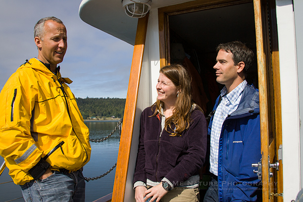 Whale researchers (Joe Gaydos, Erin and Rob) busy at work, discussing issues